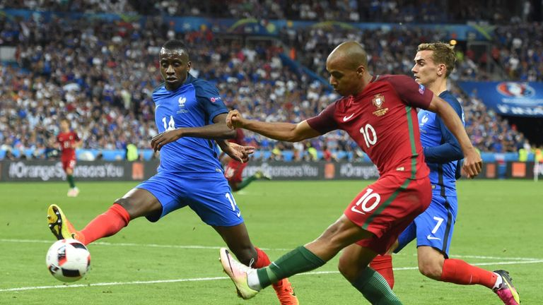 France's midfielder Blaise Matuidi (L) and Portugal's midfielder Joao Mario (C) fight for the ball next to France's forward Antoine Griezmann during the Eu