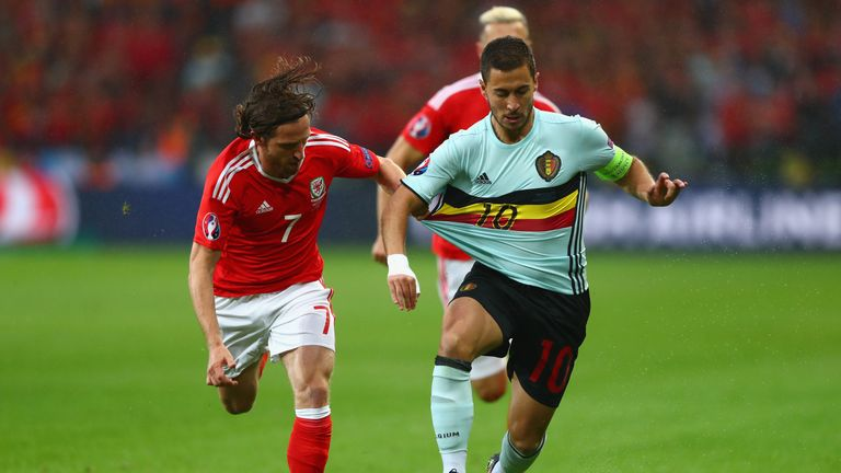 LILLE, FRANCE - JULY 01:  Eden Hazard of Belgium and Joe Allen of Wales compete for the ball  during the UEFA EURO 2016 quarter final match between Wales a
