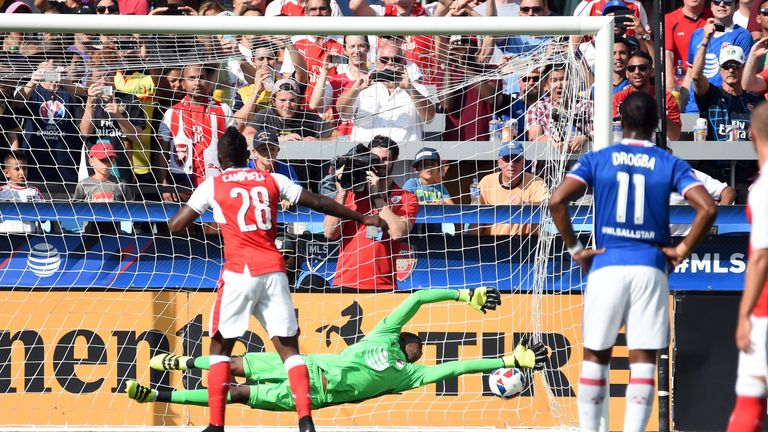 Joel Campbell (L) hammers home a penalty to open the scoring