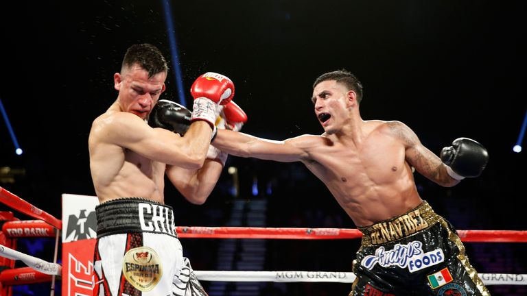 Jose Benavidez Jr. (R) lands a punch on Francisco Santana during their welterweight bout at the MGM Grand Garden Arena on July 23
