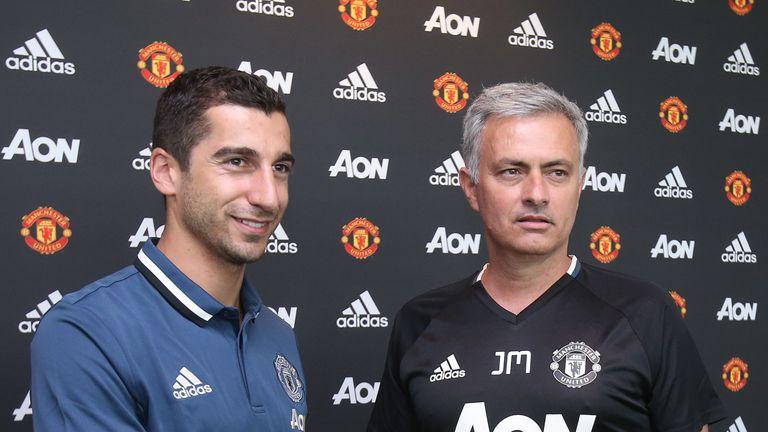 Henrikh Mkhitaryan of Manchester United poses with Manager Jose Mourinho