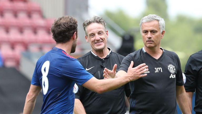 Manager Jose Mourinho of Manchester United congratulates Juan Mata