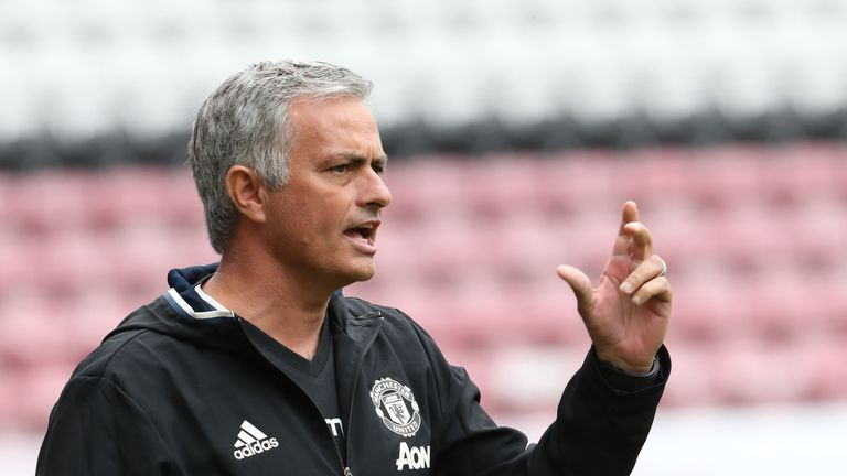 WIGAN, ENGLAND - JULY 16:  Manager Jose Mourinho of Manchester United watches from the dugout during the pre-season friendly match between Wigan Athletic a