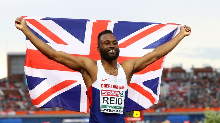 Julian Reid of Great Britain celebrates after winning bronze in the triple jump