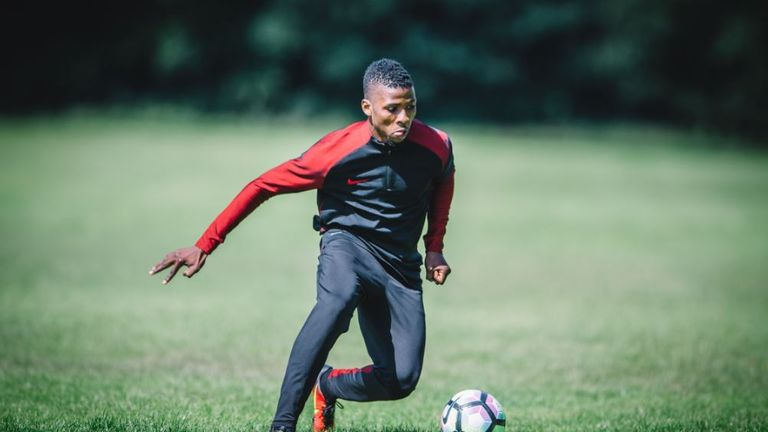 Manchester City forward Iheanacho training in Nike apparel