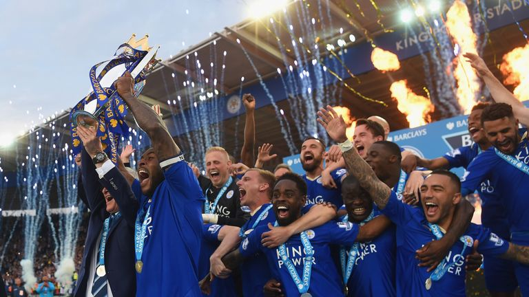 LEICESTER, ENGLAND - MAY 07:  Captain Wes Morgan and manager Claudio Ranieri of Leicester City lift the Premier League Trophy after the Barclays Premier Le