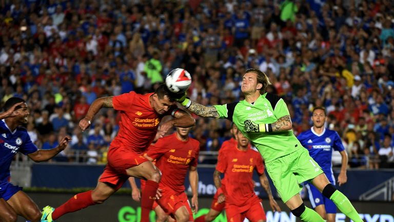 Liverpool goalkeeper Lorius Karius (R) clashes with Dejan Lovren