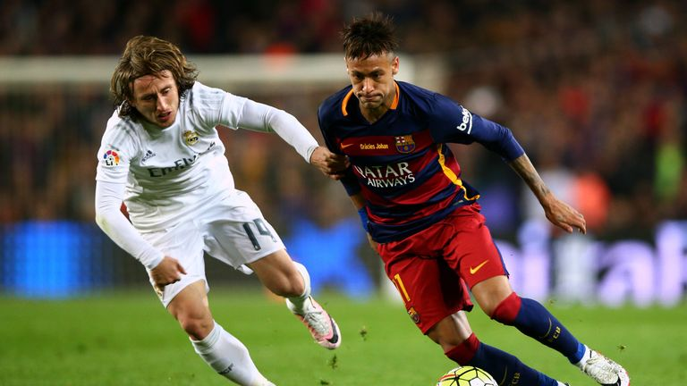 Neymar of Barcelona (right) battles for the ball with Luka Modric of Real Madrid