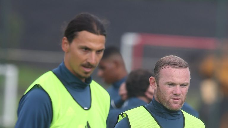 Zlatan Ibrahimovic and Wayne Rooney look on in training