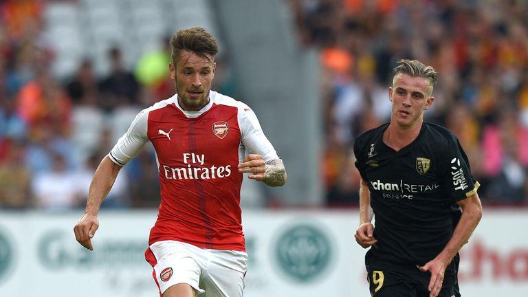 Mathieu Debuchy (L) has been in pre-season action for Arsenal