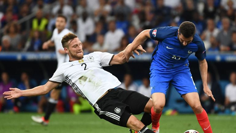 Germany's defender Shkodran Mustafi (L) vies for the ball with France's forward Andre-Pierre Gignac during the Euro 2016 semi-final football match between