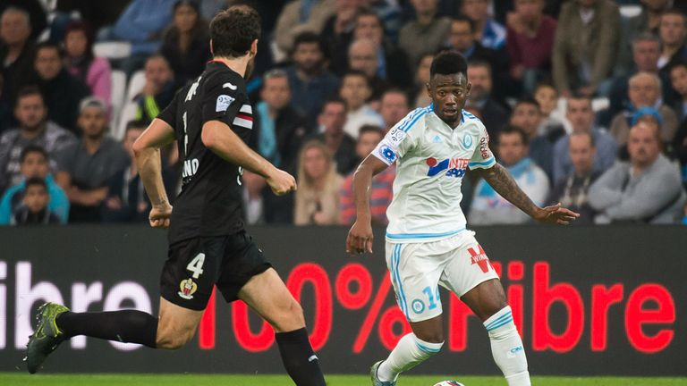 N'Koudou takes on Nice defender Paul Baysse in Ligue 1 last season while playing for Marseille