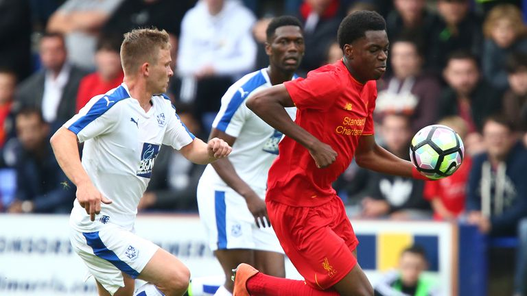 BIRKENHEAD, ENGLAND - JULY 08: Ovie Ejaria of Liverpool gets past Jay Harris of Tranmere Rovers during the Pre-Season Friendly match between Tranmere Rover