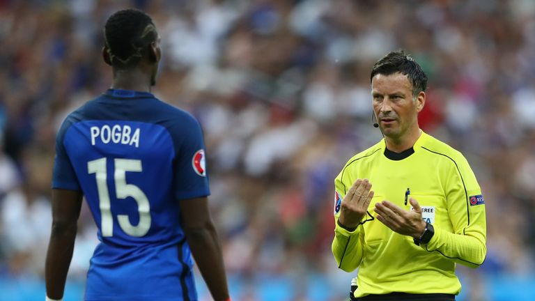 Referee Mark Clattenburg talks with Paul Pogba of France
