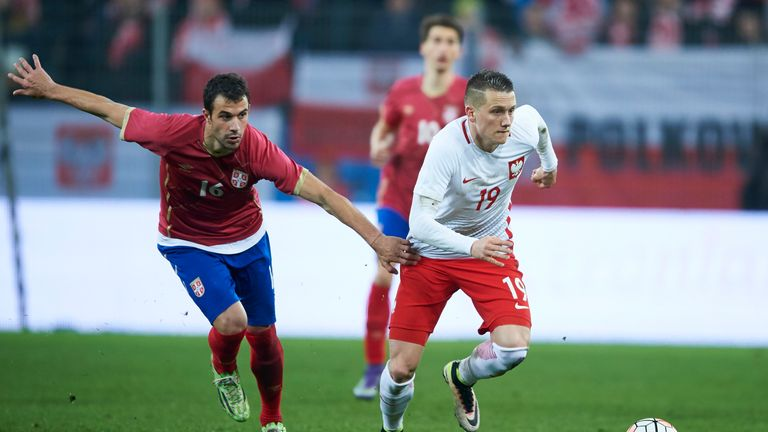 POZNAN, POLAND - MARCH 23: (R) Piotr Zielinski of Poland fights for the ball with Luka Milivojevic of Serbia during the international friendly soccer match