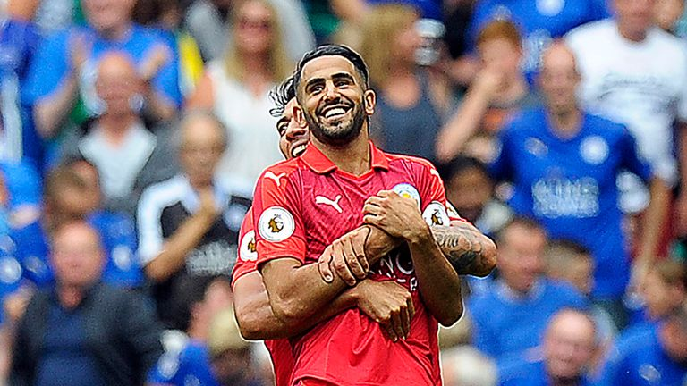 Riyad Mahrez is lifted up by Leicester team-mate Leonardo Ulloa after scoring against Celtic