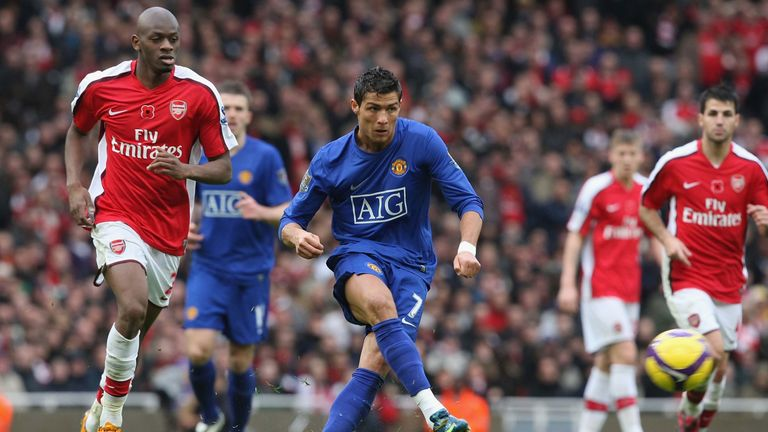 LONDON, ENGLAND - NOVEMBER 8: Cristiano Ronaldo of Manchester United clashes with Abou Diaby of Arsenal  during the Barclays Premier League match between