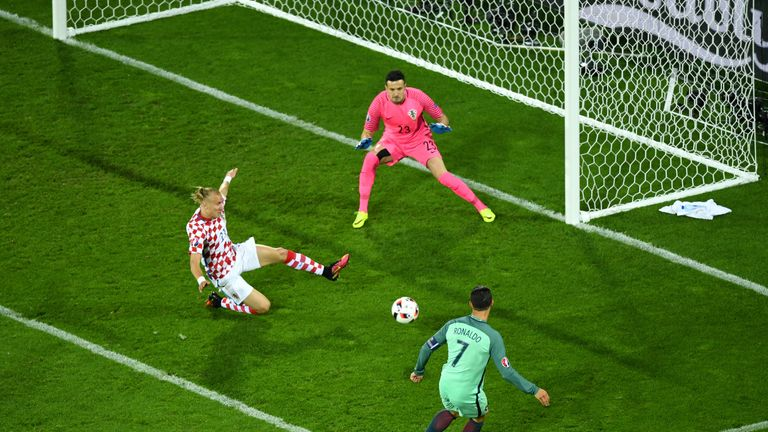 LENS, FRANCE - JUNE 25:  Cristiano Ronaldo (R) of Portugal shoots at goal saved by Danijel Subasic (C) of Croatia setting up the first goal by Ricardo Quar