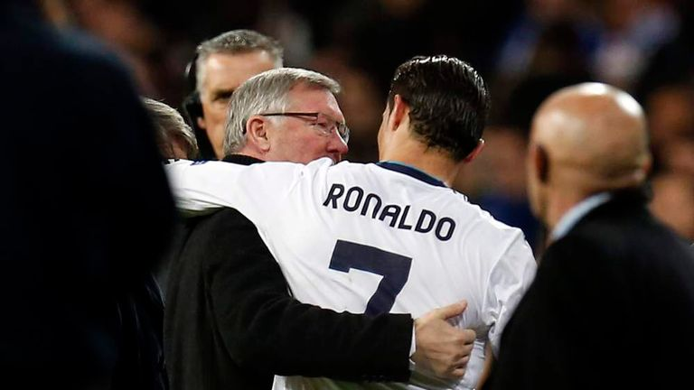 Manchester United's manager Sir Alex Ferguson speaks to Real Madrid's Cristiano Ronaldo after their Champions League soccer match at Santiago Bernabeu stadium in Madrid