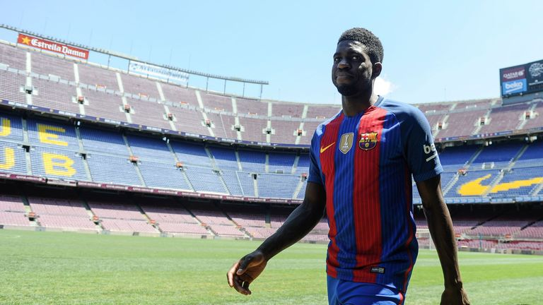 Samuel Umtiti smiles during his official Barcelona presentation at the Nou Camp