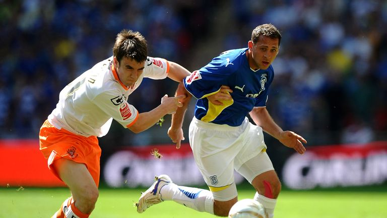 Michael Chopra of Cardiff City battles with Seamus Coleman of Blackpool during the Coca-Cola Championship Playoff Final between
