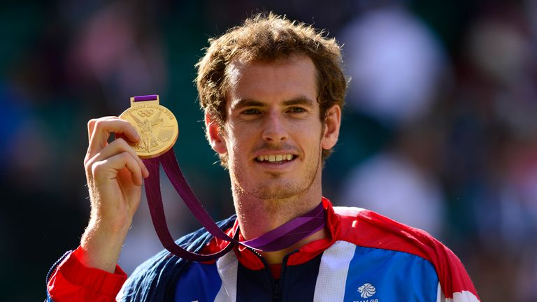 Andy Murray poses with his gold medal at the end of the men's singles of the London 2012 Olympic Games