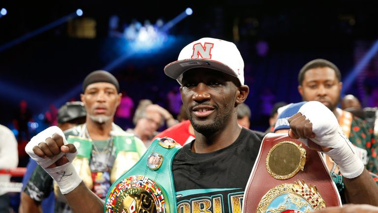 WBO junior welterweight champion Terence Crawford poses with belts after his unanimous decisionwin over WBC champion Viktor  Postol