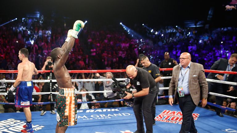 WBO junior welterweight champion Terence Crawford raises his arms in victory after going 12 rounds against WBC champion Viktor Postol