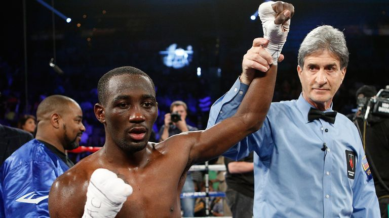 Terrence Crawford reacts after defeating Bredis Prescott
