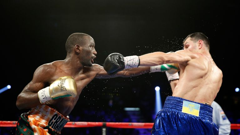 WBO junior welterweight champion Terence Crawford (L) punches WBC champion Viktor Postol of Ukraine during their unification figh