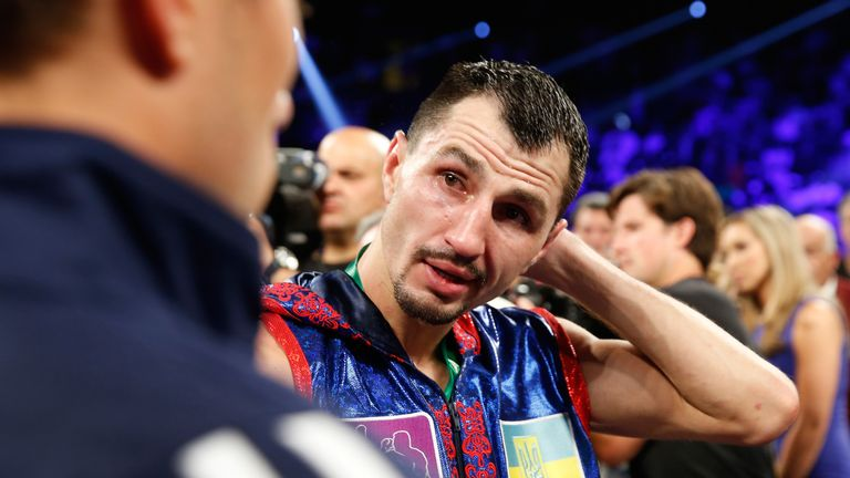 LAS VEGAS, NV - JULY 23:  Viktor Postol of Ukraine talks with a member of his team after his loss to WBO junior welterweight champion Terence Crawford.