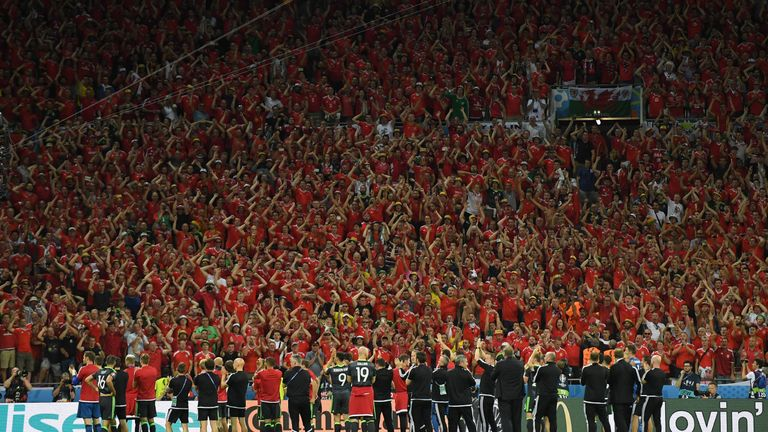 LYON, FRANCE - JULY 06:  Wales players and staffs applaud supporters after the UEFA EURO 2016 semi final match between Portugal and Wales at Stade des Lumi