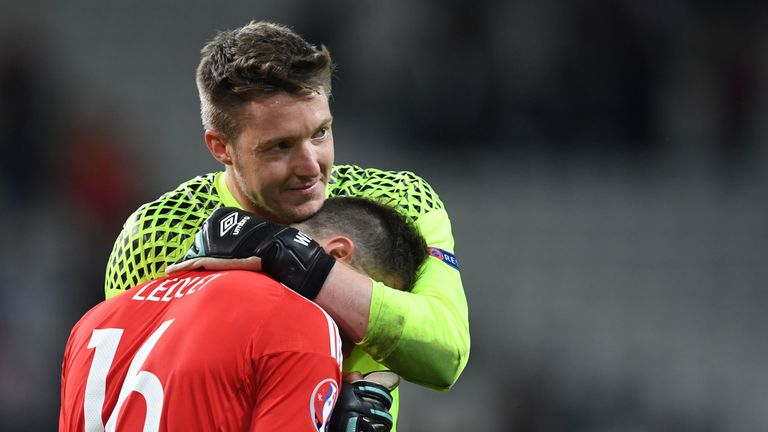 Wales' midfielder Joe Ledley (front) and Wales' goalkeeper Wayne Hennessey celebrate after the Euro 2016 quarter-final football match between Wales and Bel