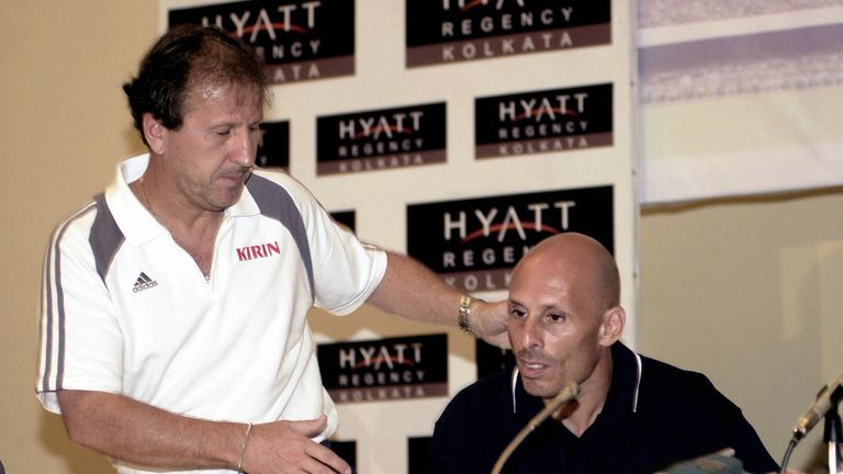 Brazilian coach of the Japan national football team Zico shakes hands with British coach of the India national team Stephen Constantine in 2004