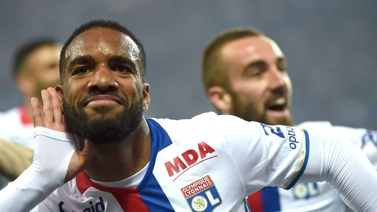 Alexandre Lacazette (C) celebrates after scoring for Ligue 1 side, Lyon