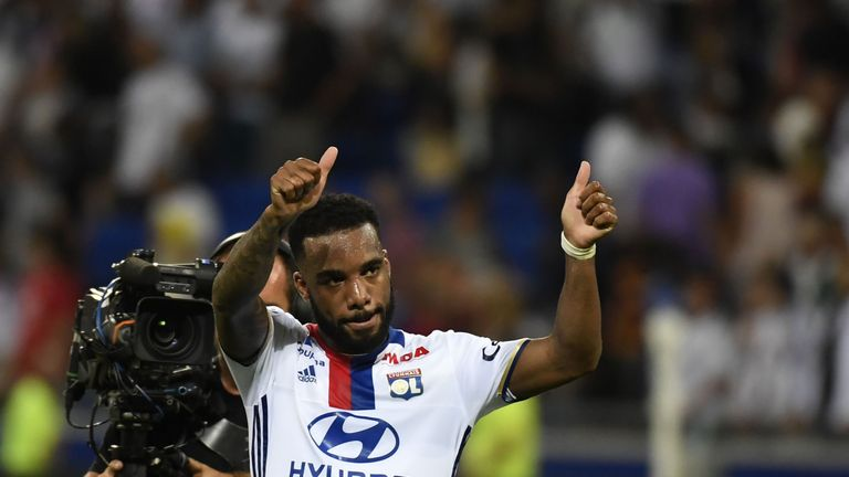 Lyon's French forward Alexandre Lacazette (L) gestures after scoring his second goal during the French Ligue 1 football match Olympique Lyonnais (OL) again