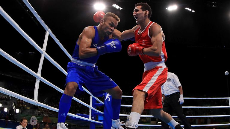 Former world champion Amnat Ruenroeng (left) suffered a KO defeat