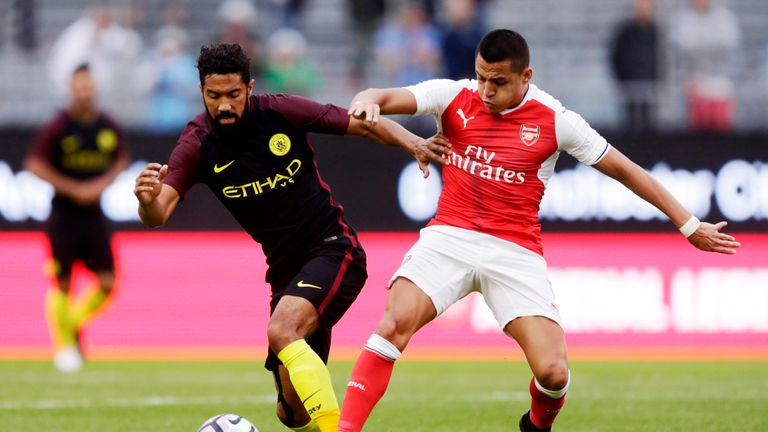 GOTHENBURG, SWEDEN - AUGUST 07: Gael Clichy of Manchester City and Alexis Sanchez of Arsenal competes for the ball during the Pre-Season Friendly between A