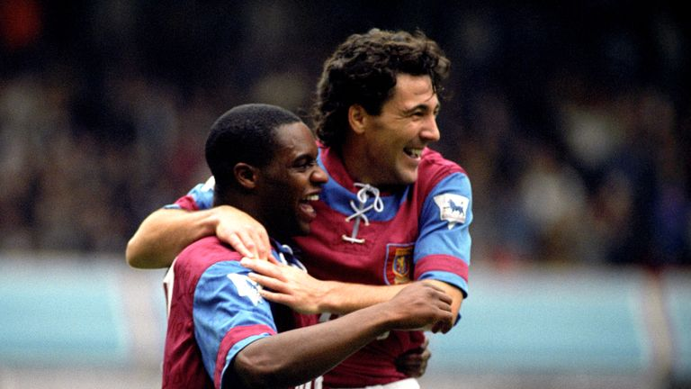 Dean Saunders (right) congratulates Atkinson after scoring for Villa