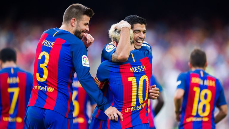 BARCELONA, SPAIN - AUGUST 20: Luis Suarez (R) of FC Barcelona celebrates with his teammates Lionel Messi (C) and Gerard Pique (L) after scoring his team's