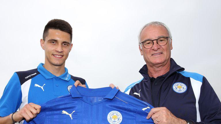 Bartosz Kapustka (left) poses with Leicester manager Claudio Ranieri
