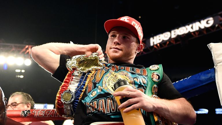 Canelo Alvarez stands with the WBC middleweight belt after defeating Amir Khan with a sixth-round knockout at a WBC middleweight title