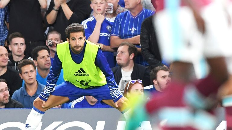 Cesc Fabregas looks on from the sidelines at Stamford Bridge