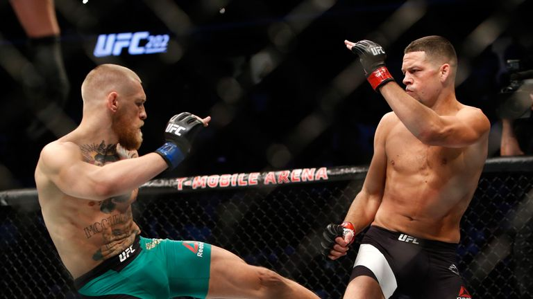 LAS VEGAS, NV - AUGUST 20:  Conor McGregor (L) kicks Nate Diaz during their welterweight rematch at the UFC 202 event at T-Mobile Arena on August 20, 2016