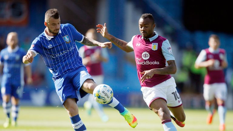 Sheffield Wednesday's Daniel Pudil and Aston Villa's Jordan Ayew battle for the ball