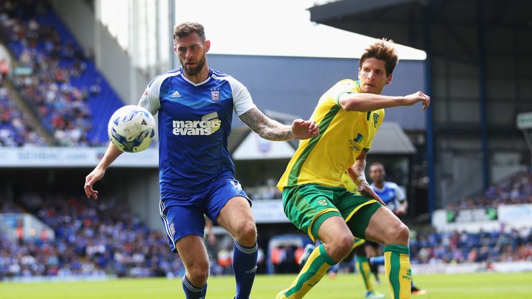 Daryl Murphy of Ipswich Town is closed down by Timm Klose of Norwich City during the Sky Bet Championship match
