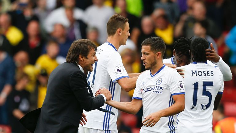 Hazard says he is enjoying his time playing under Antonio Conte (L)