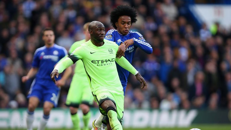 LONDON, ENGLAND - APRIL 16: Eliaquim Mangala of Manchester City is tackled by Willian of Chelsea during the Barclays Premier League match between Chelsea a