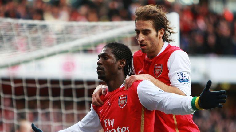 LONDON - JANUARY 12: Emmanuel Adebayor and Mathieu Flamini of Arsenal celebrate Adebayor's penalty during the Barclays Premier League match between Arsenal