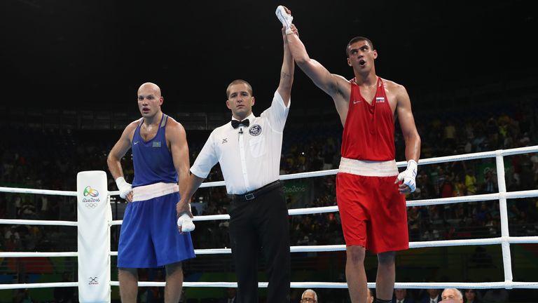 Evgeny Tishchenko celebrates his controversial gold